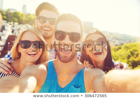 group of young people by barbecue stock photo © is2