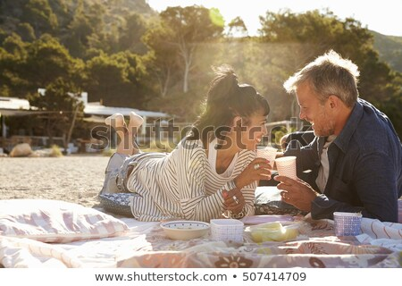 middle aged couple on a picnic blanket stock photo © is2