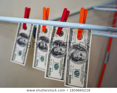 red clothespin and dollar stock photo © devon