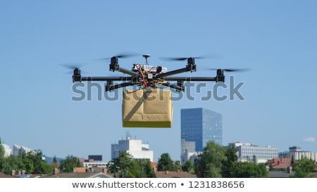 multicopter drone with package flying in the sky Stock photo © unkreatives