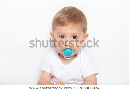 small baby boy looking at plastic toys stock photo © giulio_fornasar