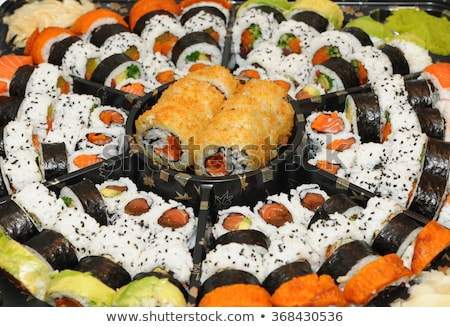 Several pieces of sushi roll california Stock photo © Cipariss