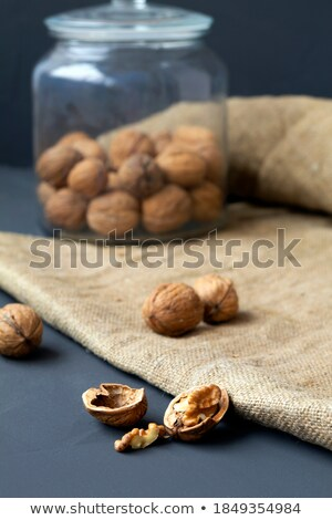 Unpeeled brown coconut on table Stock photo © dash
