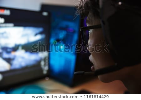 photo closeup of excited asian gamer boy playing video games onl stock photo © deandrobot