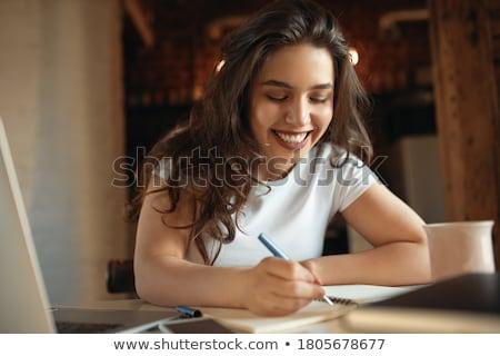 Genç kız bilgisayar tablo açık kitap eller güzel Stok fotoğraf © Traimak