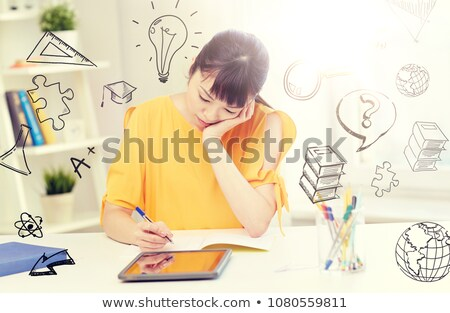 Stock photo: bored asian woman student with tablet pc at home