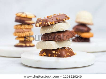 luxury belgian chocolate and biscuit cookies selection in original golden tray and white kitchen tab stock photo © denismart