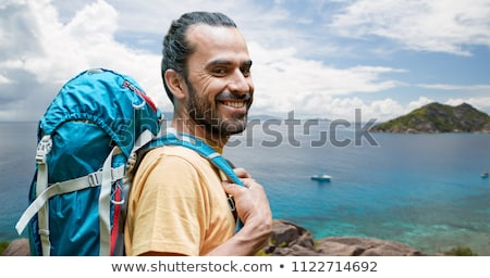 Stock photo: smiling man with backpack over seychelles