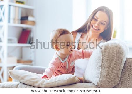 genç · anne · bebek · kız · kanepe · ev - stok fotoğraf © lopolo