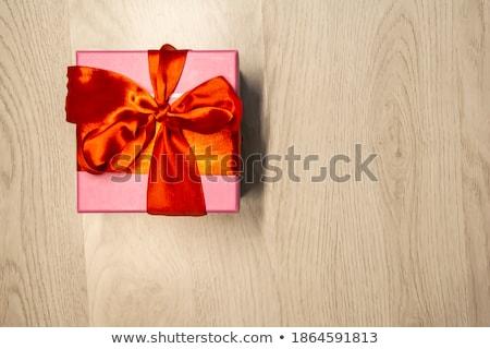 Stock fotó: Három · színes · ajándékdobozok · íjak · szürke · fából · készült