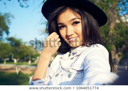 Girl with scarf making make-up Stock photo © Massonforstock