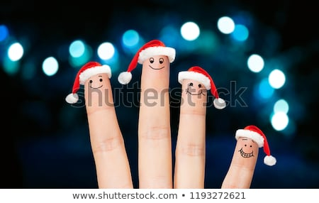 Cztery palce Święty mikołaj światła Zdjęcia stock © dolgachov