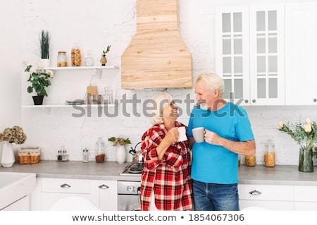 Kezek kortárs érett férj feleség ül Stock fotó © pressmaster