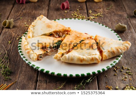 Delicious hot Calzone pizza isolated Stock photo © fanfo