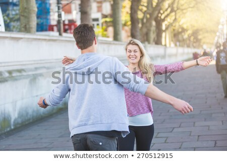 happy couple boy and girl running to each other stock photo © robuart