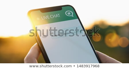 Femme smartphone chat demande Photo stock © AndreyPopov