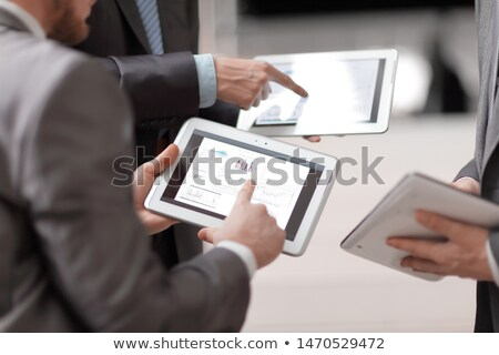 business team hands at working with financial plan and a tablet stock photo © freedomz