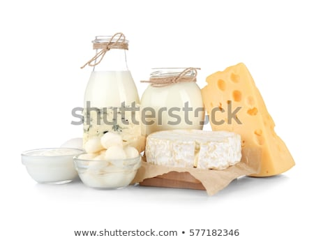 Stock photo: Fresh dairy products on white table background. Jar and glass of milk, bowl of sour cream, cottage c