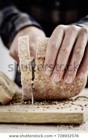 man cutting a spelt bread roll Stock photo © nito