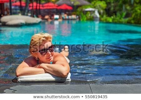 mooie · zwemmer · permanente · zwembad · glimlachend · camera - stockfoto © dash