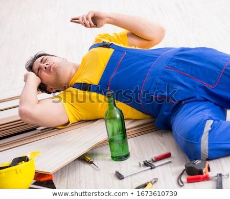 Floor repairman drinking alcohol during break Stock photo © Elnur