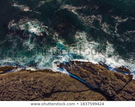 views of waves tossing around rocks in the ocean stock photo © lovleah