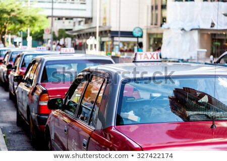 A fleet of Hong Kong taxis waiting at a taxi stand. Hong Kong taxis are easily recognizable by their Stock photo © galitskaya