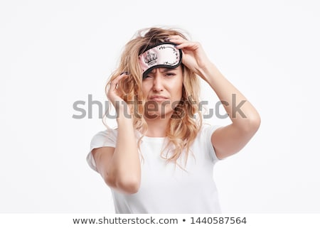 woman in pajama and eye mask with coffee yawning Stock photo © dolgachov