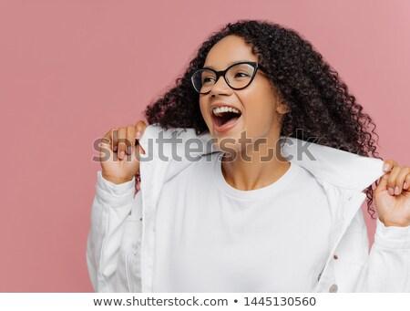 Kadın mutlulukla eller beyaz ceket Stok fotoğraf © vkstudio