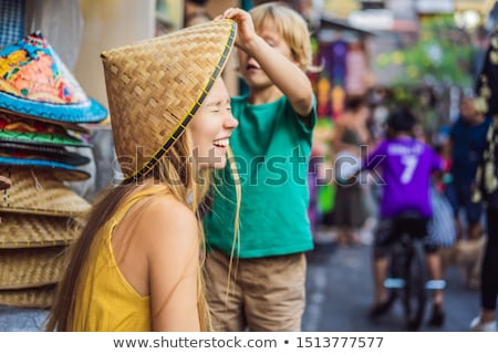 Mom and son travelers choose souvenirs in the market at Ubud in Bali, Indonesia Stock photo © galitskaya