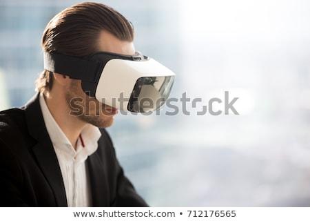 Empresário olhando virtual realidade óculos aviso Foto stock © ra2studio
