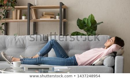 Young teenage girl taking a nap on the sofa Stock photo © Giulio_Fornasar