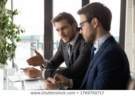 Businesspeople in a startup business discussing financials Stock photo © Kzenon