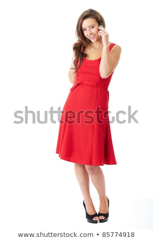 woman in red dress calling on a cell phone stock photo © paha_l
