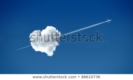 heart on the clouds with arrows stock photo © dayzeren