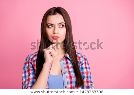 Young woman thinking or with a question Stock photo © lovleah