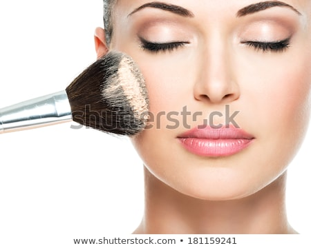 Stock photo: Woman's face and makeup brush