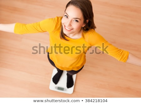Exuberant young brunette woman. Stock photo © lithian