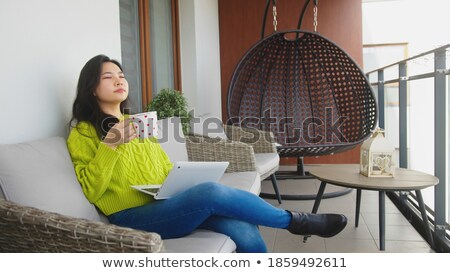 Beautiful Woman Enjoys Her Warm Drink and Laptop stock photo © feverpitch