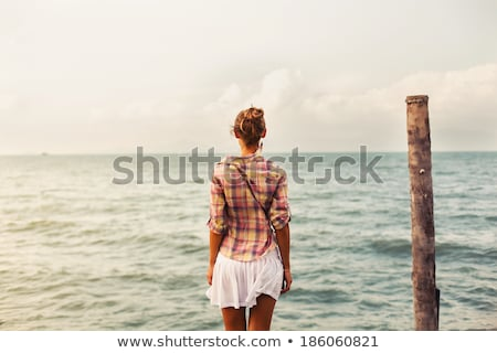 Portre güzel genç kadın ayakta açık havada beyaz Stok fotoğraf © HASLOO