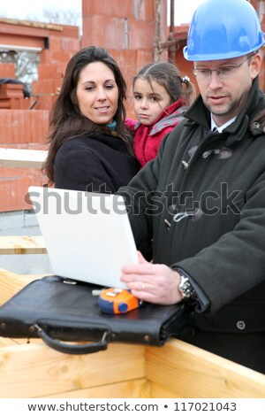 Architect reviewing digital technical drawings for his client Stock photo © photography33