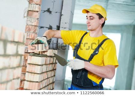 Man laying bricks Stock photo © photography33