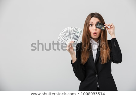 Young Businesswoman Holding Credit Card And Cash Stock photo © williv