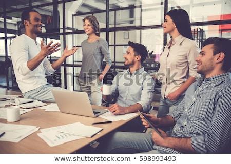 Pracy zespołu spotkanie kobieta Internetu człowiek Zdjęcia stock © ambro