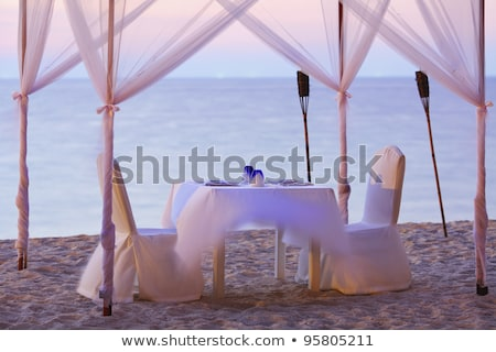A good place for romantic dinner on the beach. Long exposure sho Stock photo © moses