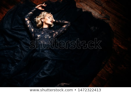Stunning blond lady posing in the evening Stock photo © konradbak