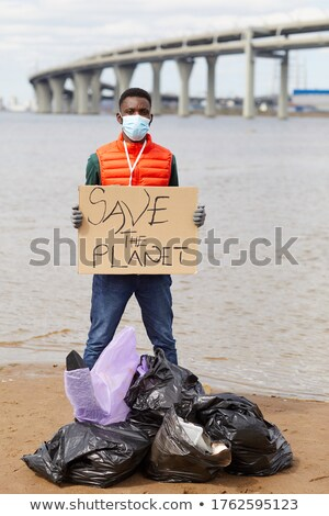 manual worker holding a recycle sign stock photo © photography33