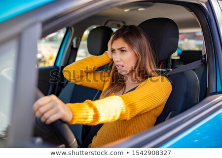 Stressed Mixed Race Woman Driving in Car and Traffic Stock photo © feverpitch