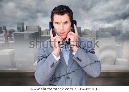Mérges üzletember felfelé telefon drótok fehér Stock fotó © wavebreak_media