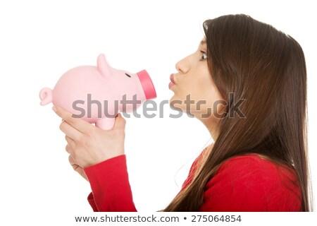 Femme baiser jeune femme rose tirelire main Photo stock © emese73
